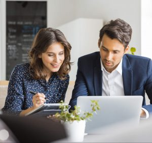 man and woman working together on the computer